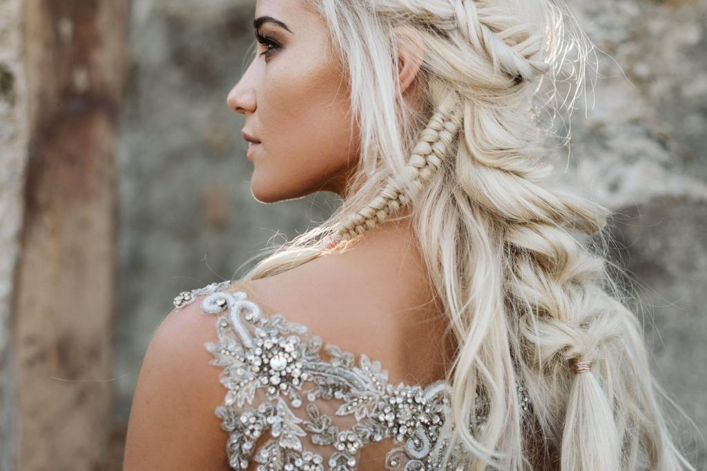 A closeup of a bride wearing a sparkly wedding dress.