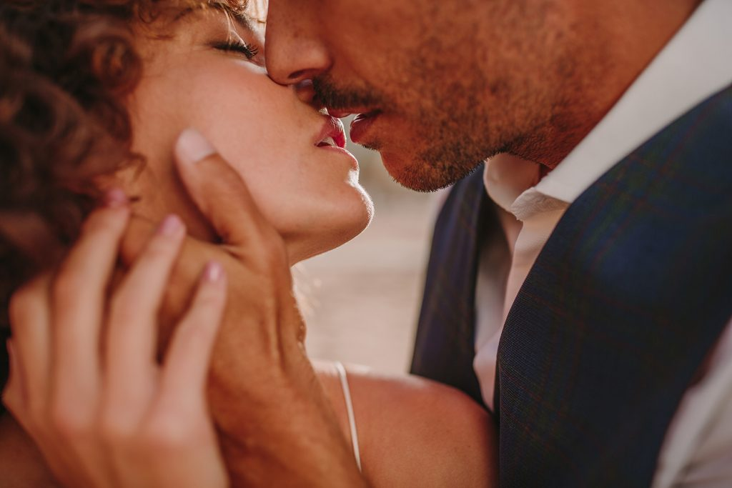 Closeup of a couple that is about to kiss each other.