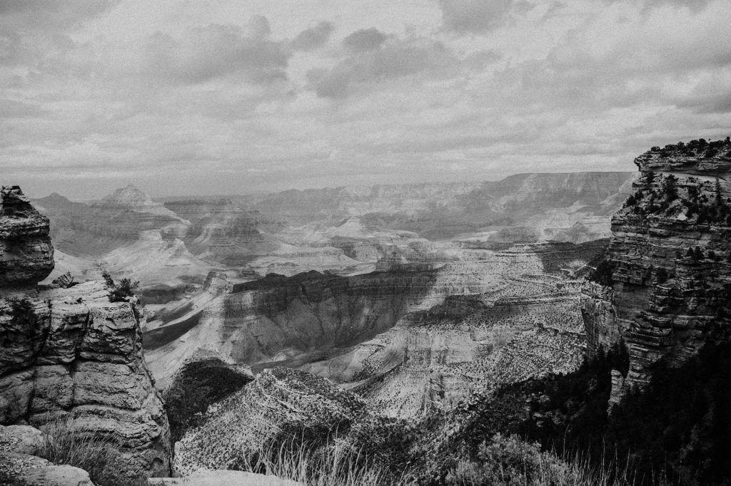 A black and white landscape picture of the Grand Canyon.
