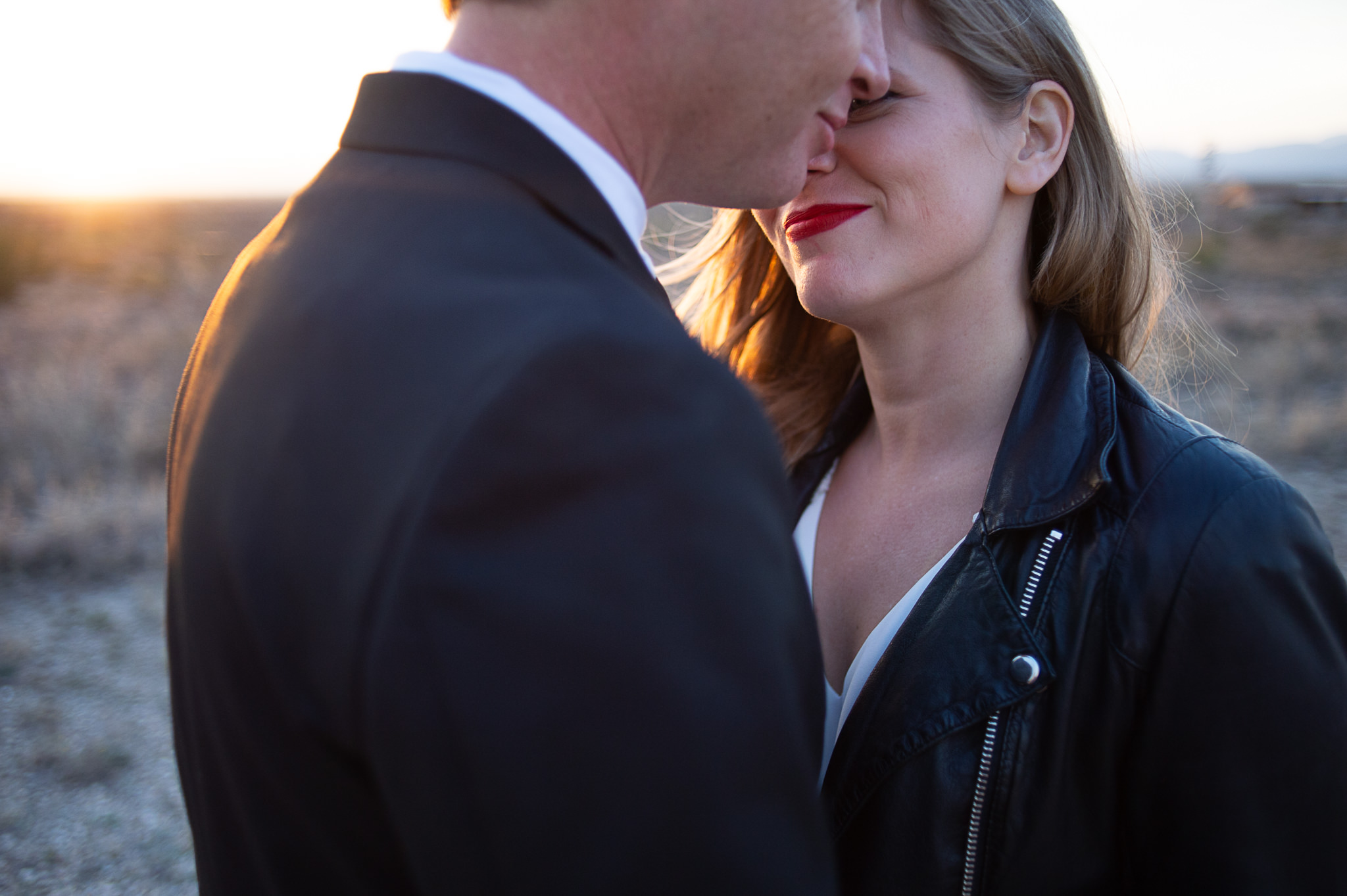 An unedited photo of a couple who puts their heads close together.
