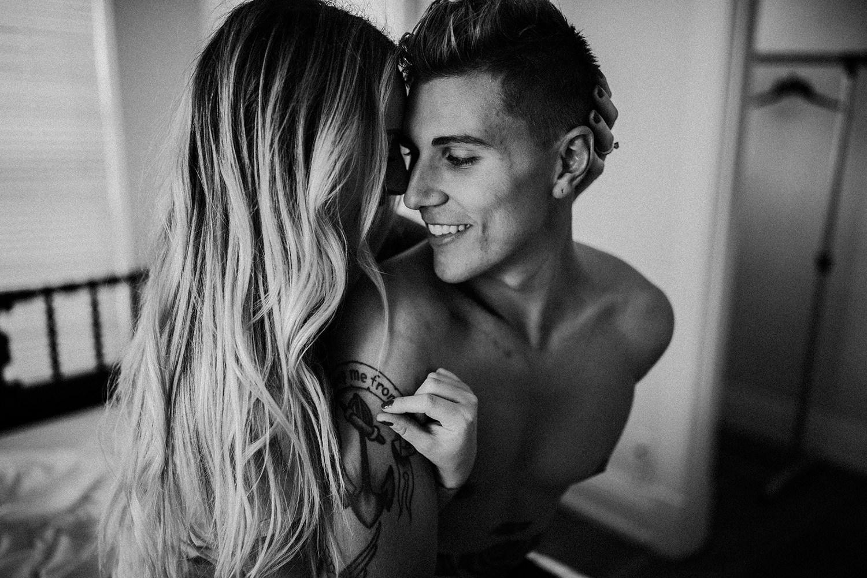A woman wraps her arms around her boyfriend.