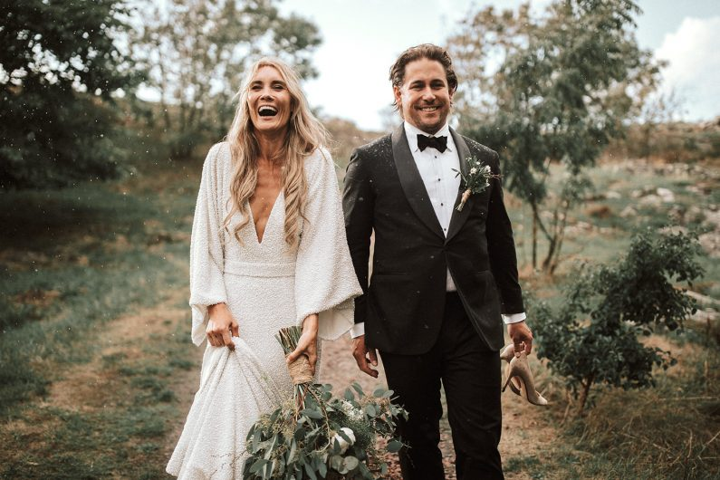 A wedding couple laughs and has the best time.