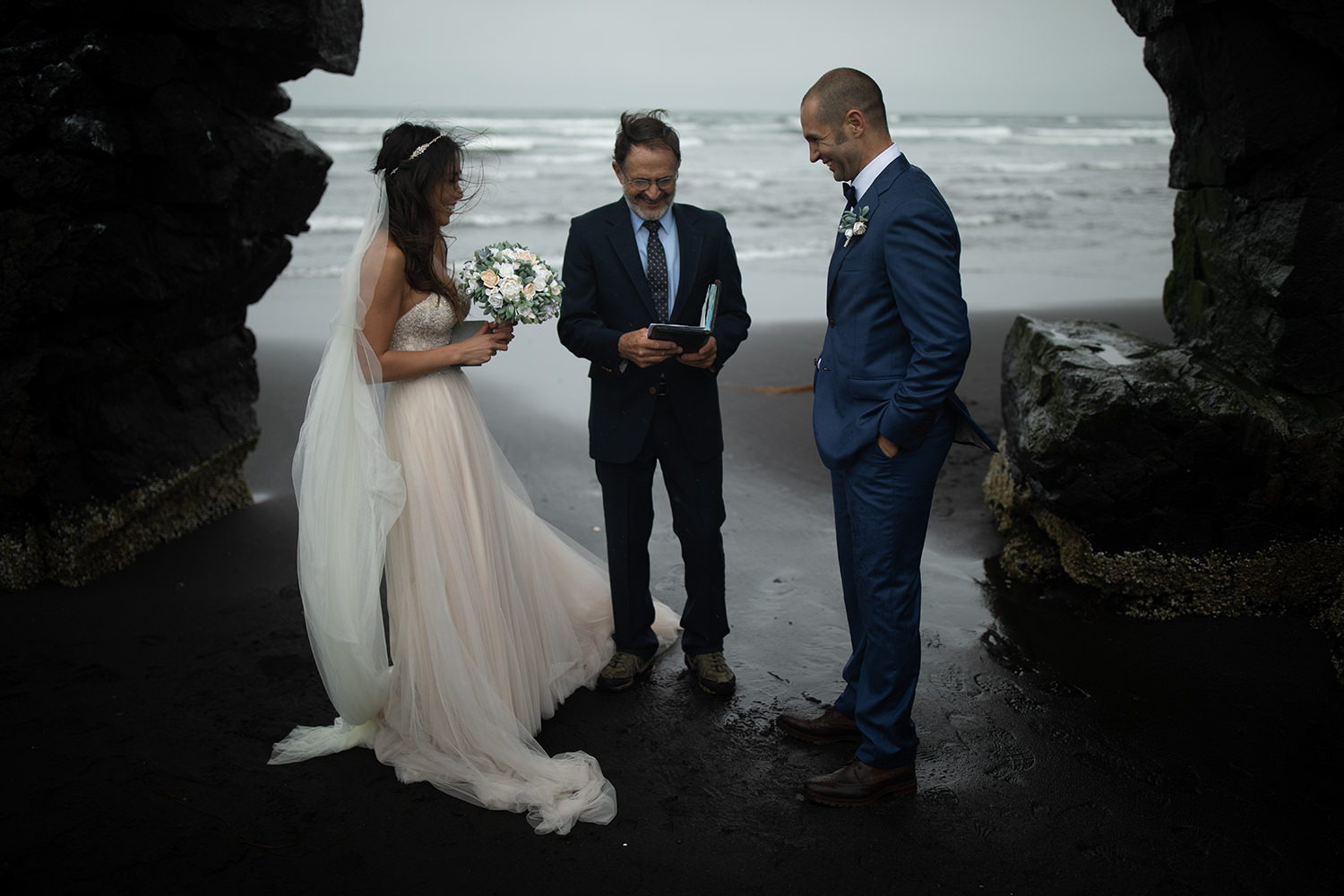 An unedited photo of a wedding ceremony takes place at a beach.