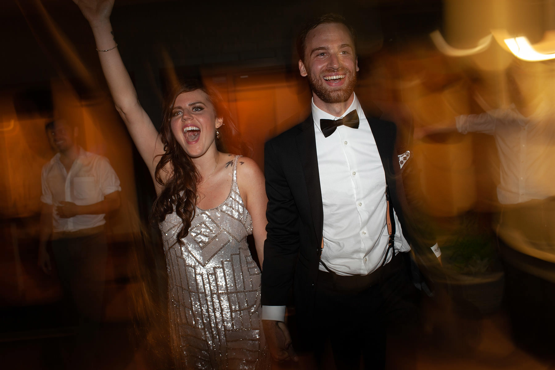 An unedited photo of a wedding couple that smiles and is ready to rock the dancefloor.