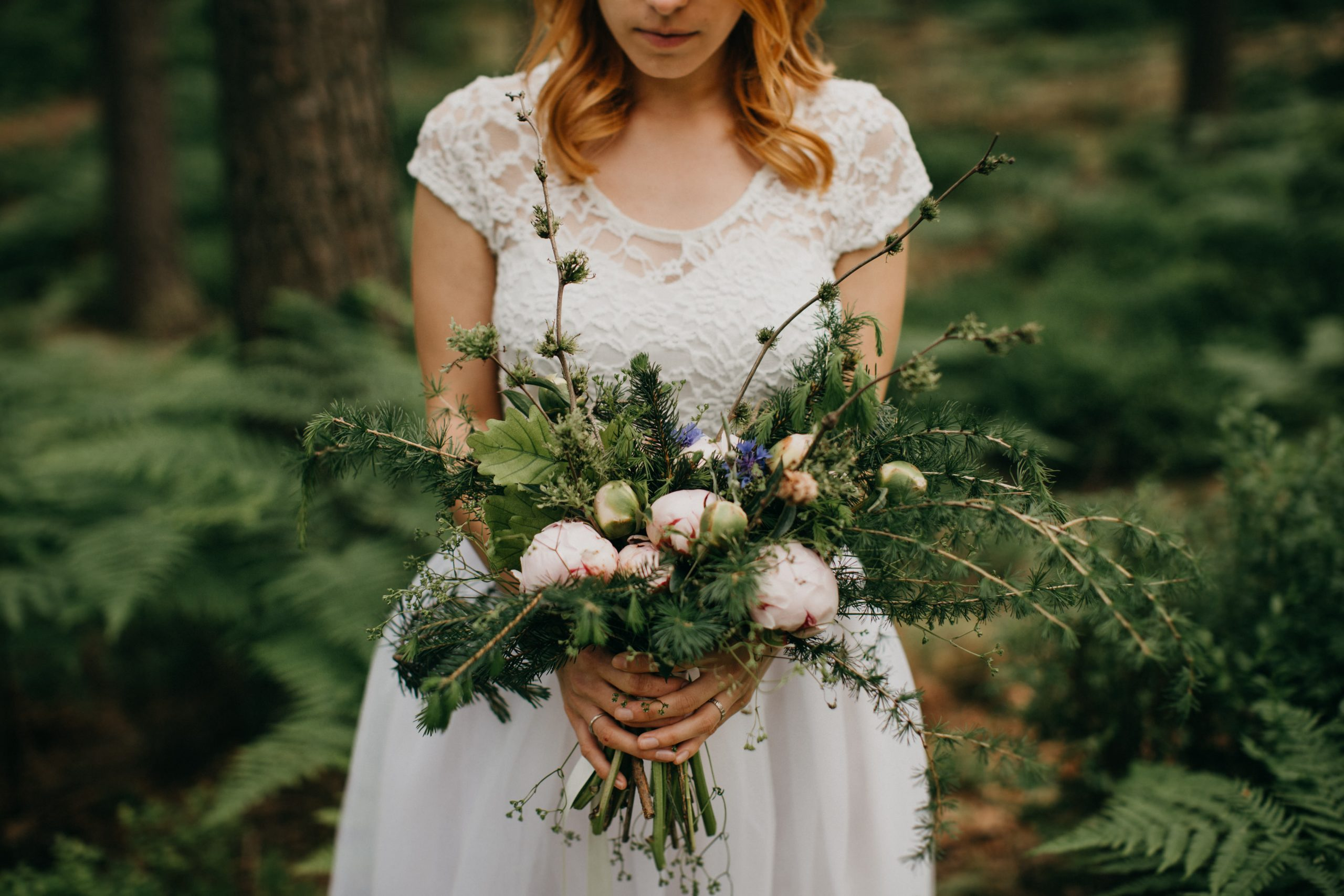 A photo of a bride holding her bridal bouquet.