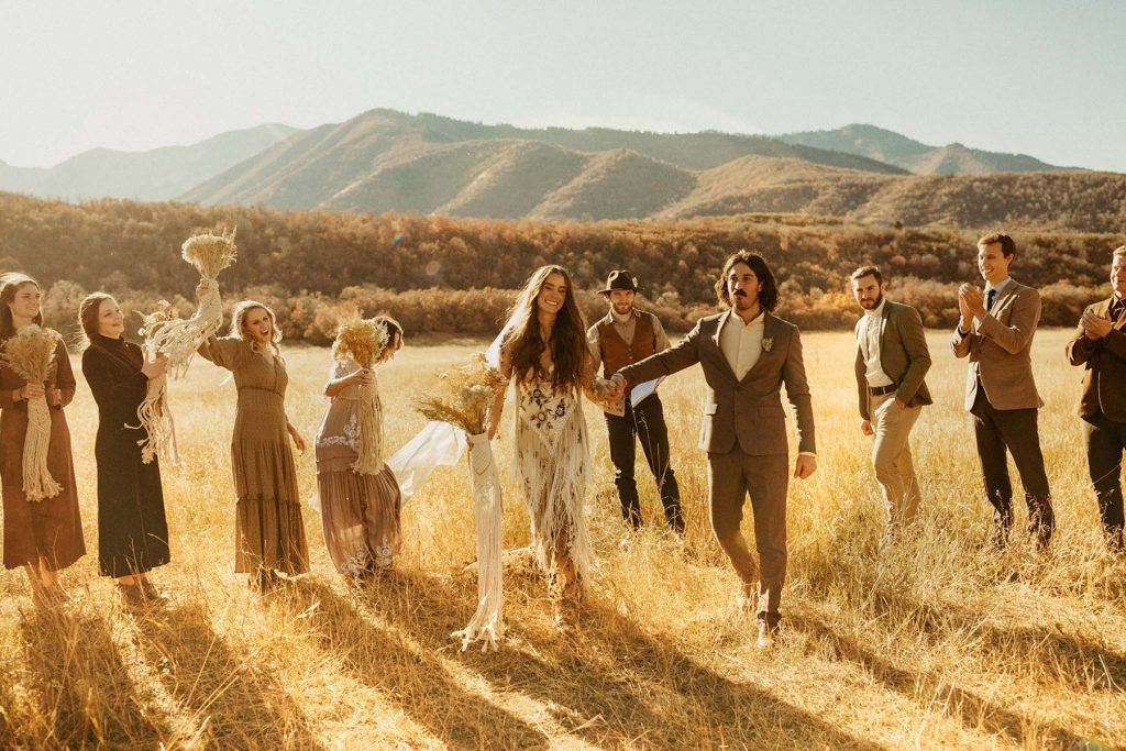 A wedding couple celebrates their outdoor wedding with guests