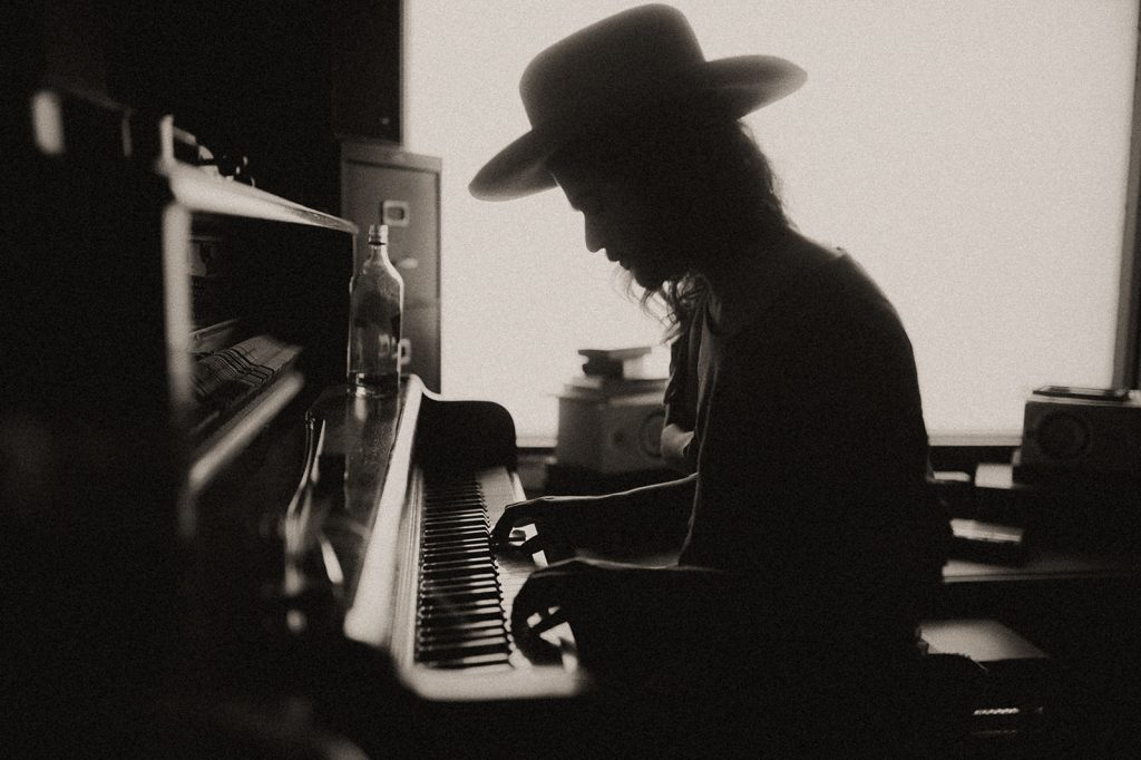 A man is playing piano.
