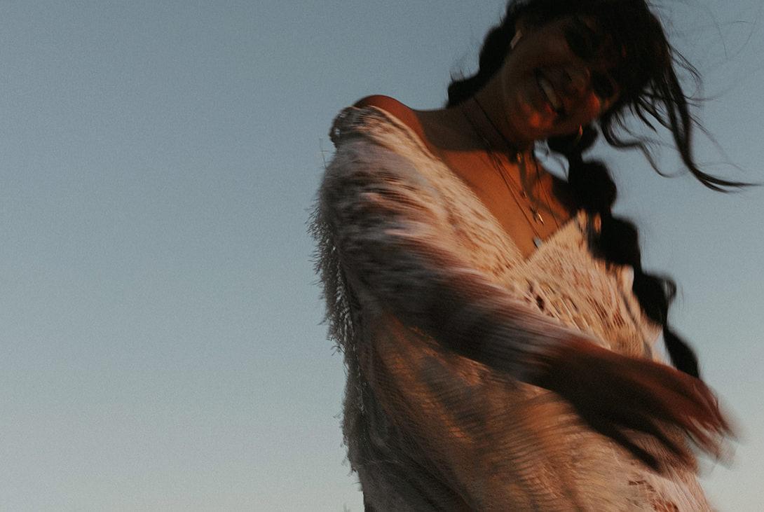 A closeup of a woman laughing at the camera.